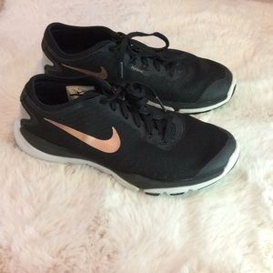 Woman's Nike rose gold shoes.